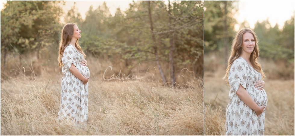 sunset maternity session in Portland field with mother with long hair and vintage dress holding baby
