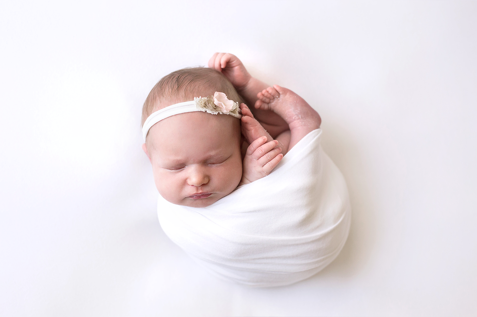 Naturally wrapped newborn baby
